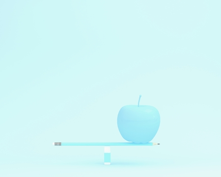 Creative made of apple on balance scale on blue color background. minimal food concept. depicts balancing between health and working, education Reklamní fotografie