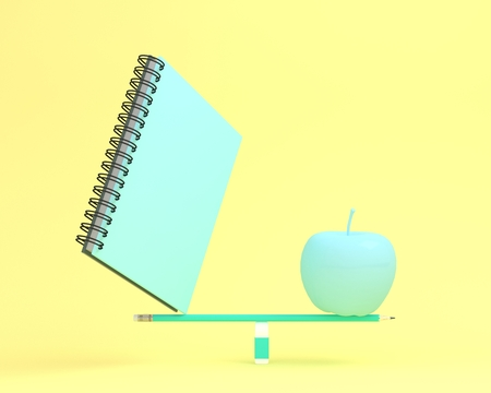Creative made of notebook with apple on balance scale on yellow color background. minimal idea business concept. depicts balancing between health and working, education Reklamní fotografie