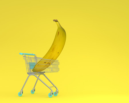 Creative idea layout shopping cart with banana on yellow pastel background. minimal idea food and fruit concept. Ideas creatively to produce work within an advertising marketing communications