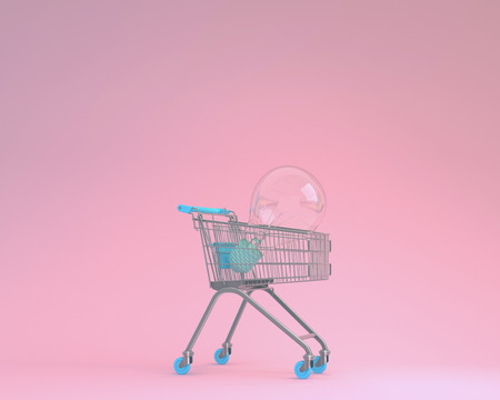 Creative idea layout shopping cart with blue light bulbs on pink pastel background. minimal business concept. Ideas creatively to produce work within an advertising marketing communications