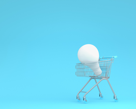 Shopping cart with white light bulbs on blue color background. minimal business ideas. concept of retail consumers and shoppers looking for bargains and low prices at the mall or department stores.