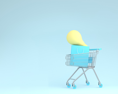 Shopping cart with shopping bags and light bulbs on blue color background. minimal business ideas. concept of retail consumers and shoppers looking for bargains and during the promotion