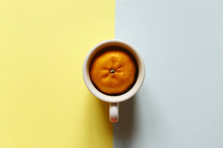 Creativity of orange with cup on pastel pink and blue background. Minimal idea summer concept Stock fotó