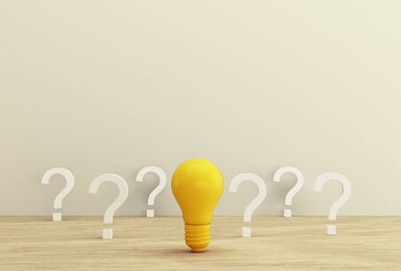 Minimal concept creative idea and innovation. Yellow light bulb revealing an idea with question symbol on a wood background. Stock fotó