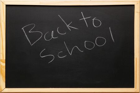 Frame chalkboard texture back to school board display for background. chalk traces erased with copy space for add text or graphic design. Backdrop of Education concepts.