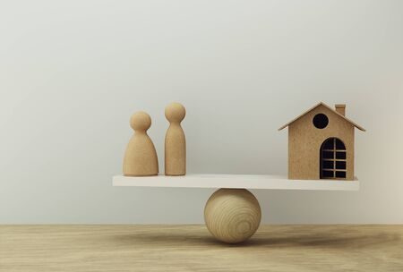 Family and house a balance scale in equal position. Family financial management, cash advance concept : depicts short term borrowing for a residence. 版權商用圖片