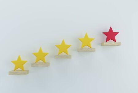 Outstanding red star shape on wooden sticks. The best excellent business services rating customer experience concept
