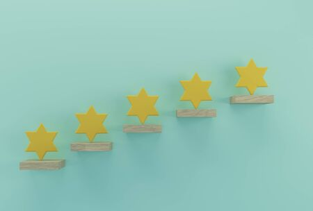 Yellow five star shape on wooden sticks. The best excellent business services rating customer experience concept