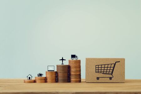 Modern business, online shopping concept : Arrange step coin and cardboard boxes for packing of goods with icon. Shipping service for online shopping using an online internet to save money and time.