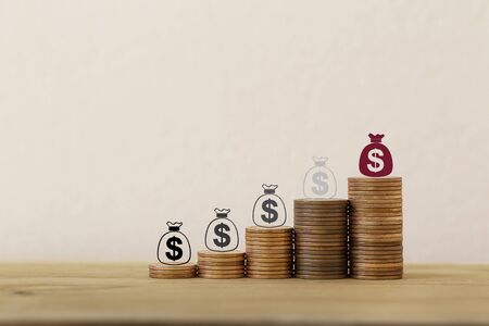 Sustainable fund concepts: Arrange icon US dollar bags on rising coins. Investment in assets from personal income for long-term financial growth. Time value of money, wealth creation