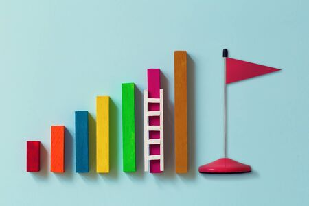 Arrange rising bar graph with stair and red flag. Concept of analysing information / Business concept growth success process: depicts the increment in annual financial budget or revenues of long term