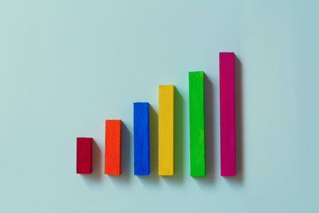 Concepts of strategic plans and business plans : create bar graphs and wooden bars.