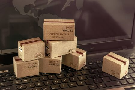Logistic, supply / Transportation and online shopping concept: Cardboard box on keyboard. International freight or shipping service for online shopping.