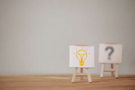 Outstanding sign stand with a light bulb icon and question mark symbol. Concept creative idea and innovation. Organization resource and talent management