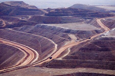Coppermines with dumptrucks Stock Photo