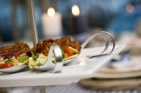 Amuse spoon on a dinner table
