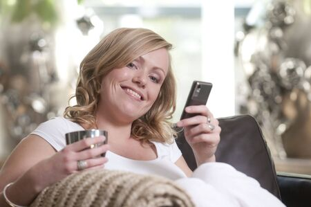 Young attractive woman messaging with her mobile phone