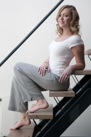 Young attractive woman posing on a stairway