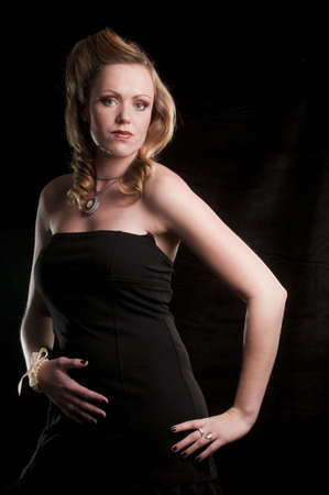 portrait of a young attractive woman against a black background photo