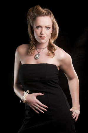 portrait of a young attractive woman against a black background Stock Photo