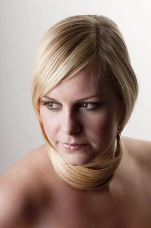 Beauty portrait of a young woman with her hair around neck.