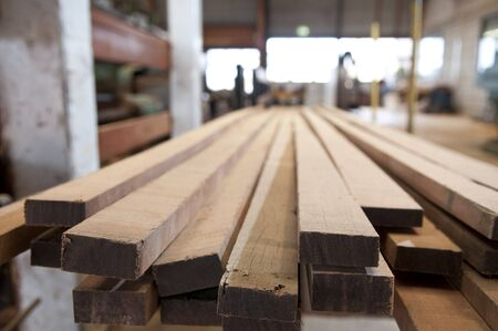 Sawed lumber at a sawmill photo