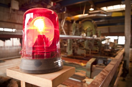 A warning light at a sawmill Stock Photo