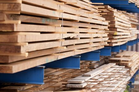 piled up wood ready for transport at a sawmill
