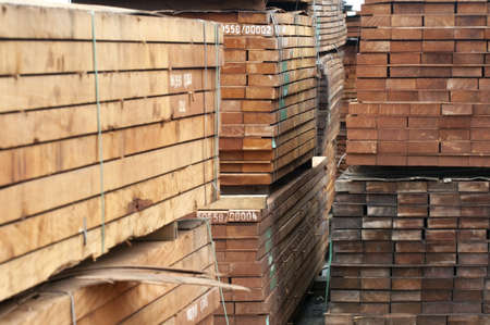 piled up wood ready for transport at a sawmill photo