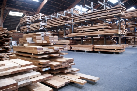 lumber mill: packed warehouse with wood ready for construction