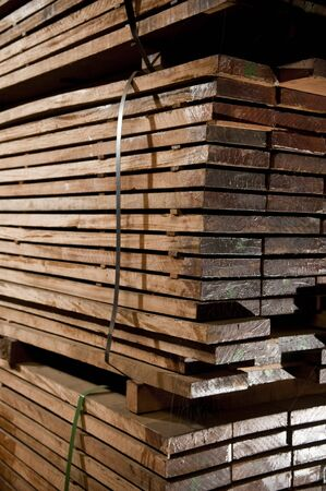 Tacks of a hardwood in lumber warehouse ready for transportation.