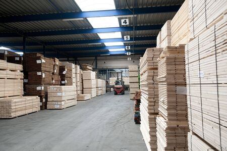 Stacked up lumber in warehouse.