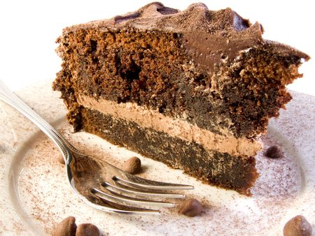 Slice of Chocolate Cake with choco power and chocolate drops with fork  photo