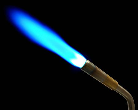 soldering: This a MAPP gas torch shot in the dark to capture blue flame Stock Photo