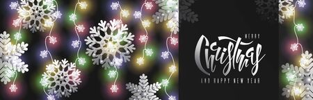 Christmas and New Year horizontal banner with garlands of sparkling light bulbs, decorative silver snowflakes and the inscription Hand lettering Christmas. Festive vector background