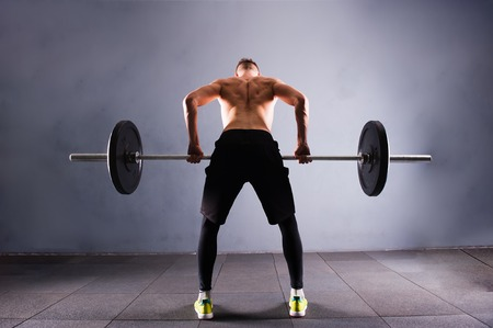 heavy weight: Crossfit fitness gym heavy weight lifting bar by strong man workout Stock Photo