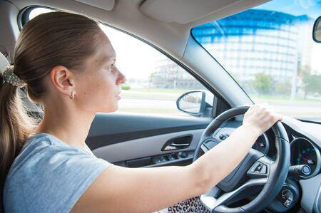 dring: one white blond attractive young woman dring a car Stock Photo