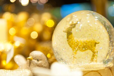 snowglobe: Christmas snow globe with an deer in snow inside of spere