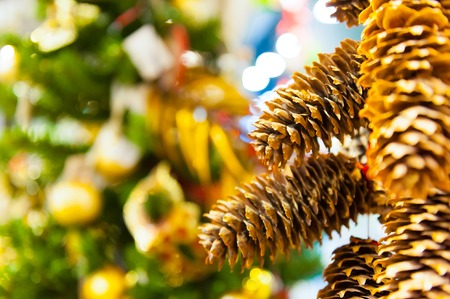 Christmas decoration background: pine and cypress cones with twigs in the background with other decorations and garlands. copy space. Stock Photo
