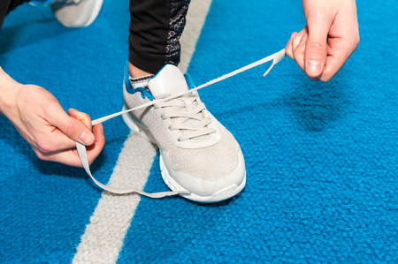 healthy lifestyle sports men tying shoelace Stock Photo