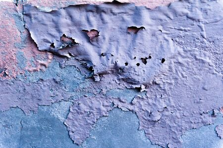 flaws: Rotten concrete wall with blown paint