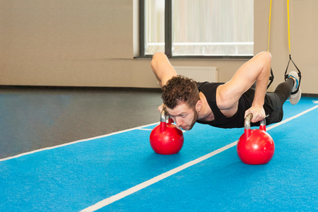 Active People Sport Workout Concept Man doing push-up exercise with dumbbell
