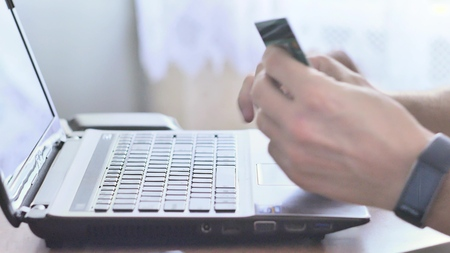 Entering credit card information into an on-line shopping site. Stock Photo
