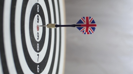 Dart hitting bulls eye, single shot bulls-eye. Concept of successful business ideas hitting the exact center of the target. Perfect performance of the task and superiority over the rivals. Imagens