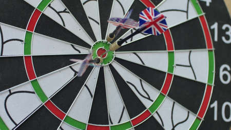 Dart hitting bulls eye, bulls-eye three shots . Concept of successful business ideas hitting the exact center of the target. Perfect performance of the task and superiority over the rivals. Reklamní fotografie
