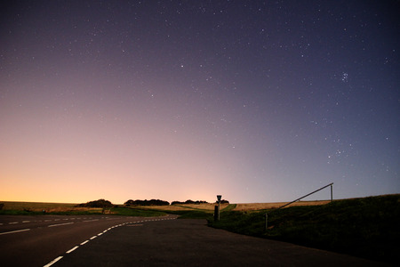 leading: Road leading to dawn with stars