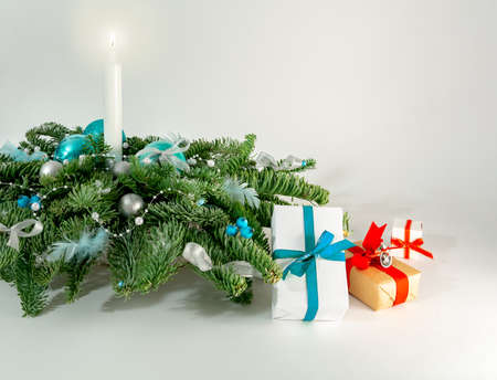 Christmas table decoration banner. Green fir branches candle gift boxes blue balls lights isolated white background. Minimalist home new year decor old style. Xmas concept copy space mock up banner