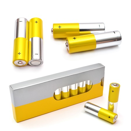 alkaline: Yellow set of batteries isolated on white. AA Alkaline batteries