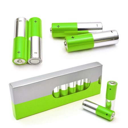alkaline: Green set of batteries isolated on white. AA Alkaline batteries