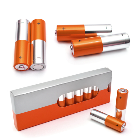 alkaline: Red set of batteries isolated on white. AA Alkaline batteries